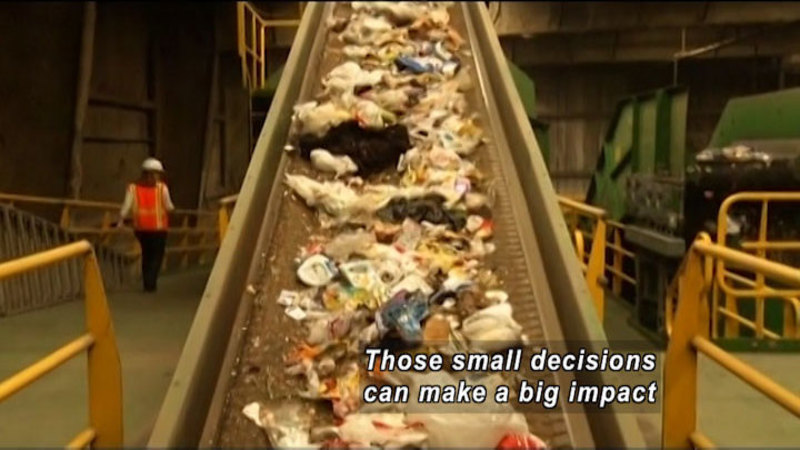 Conveyor belt with trash spread out on it. Caption: Those small decisions can make a big impact