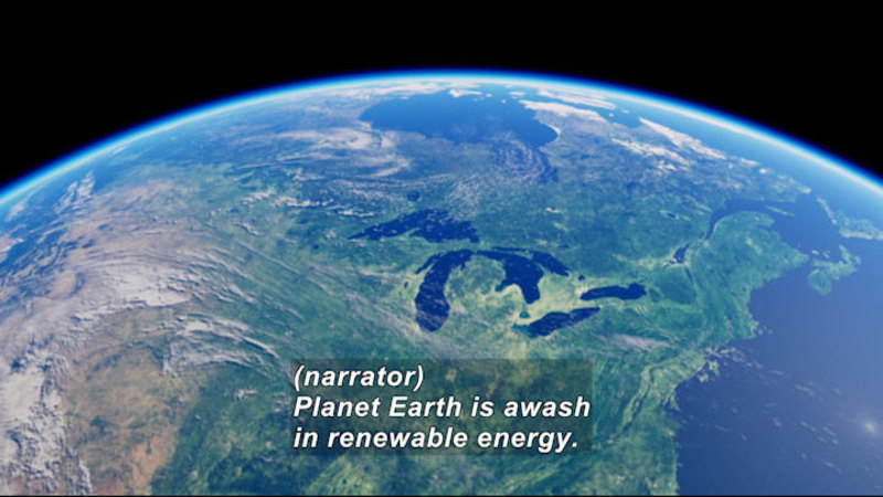 Earth as seen from space. Caption: (narrator) Planet Earth is awash in renewable energy.