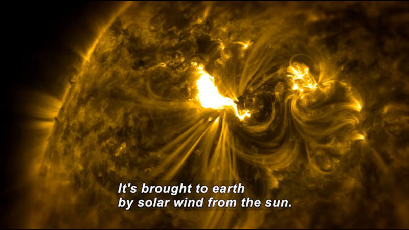 Closeup of the surface of the sun showing disturbances caused by solar wind. Caption: It's brought to earth by solar wind from the sun.