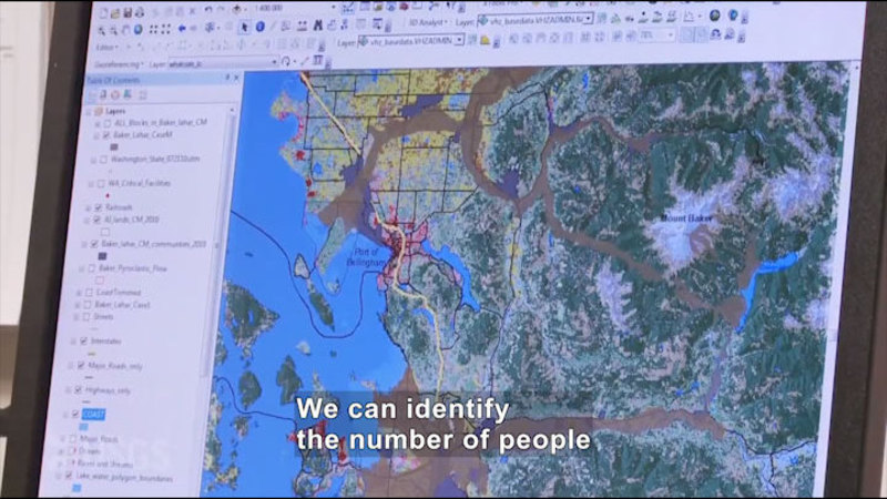 Computer screen showing a satellite map with population data. Caption: We can identify the number of people