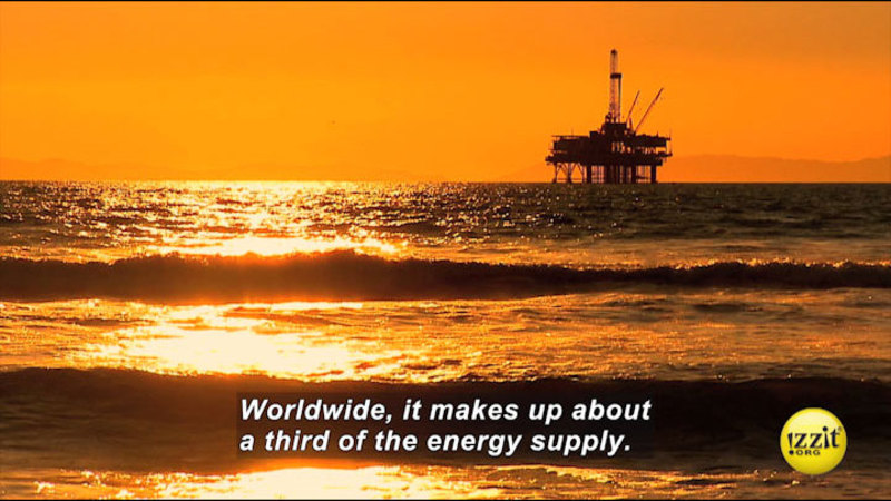 Waves at sunset looking towards an industrial platform held above the water. Caption: Worldwide, it makes up about a third of the energy supply.