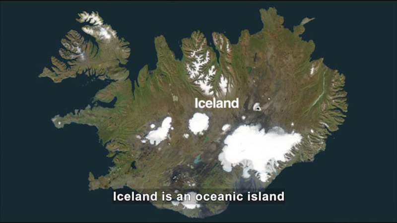 Iceland as seen from above. Mostly green with a few central patches of ice and snow. Caption: Iceland is an oceanic island