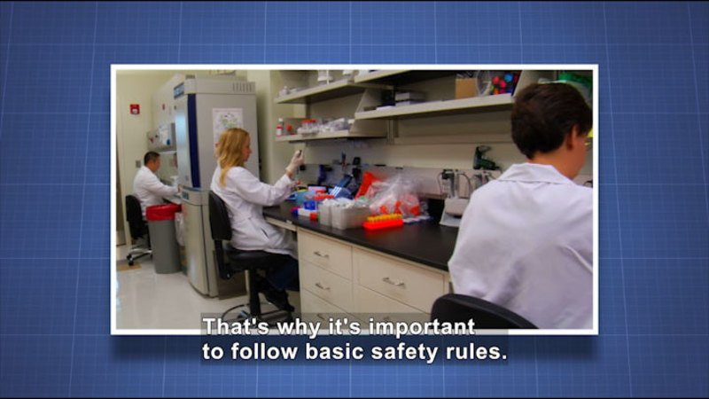 People working in a science lab. Caption: That's why it's important to follow basic safety rules.