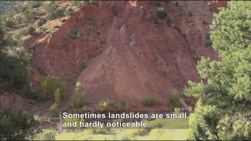 Landslide on the side of a mountain. Caption: Sometimes landslides are small, and hardly noticeable.