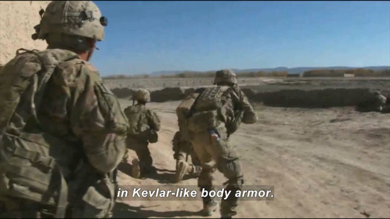 Four soldiers in a desert. Caption: in Kevlar-like body armor.