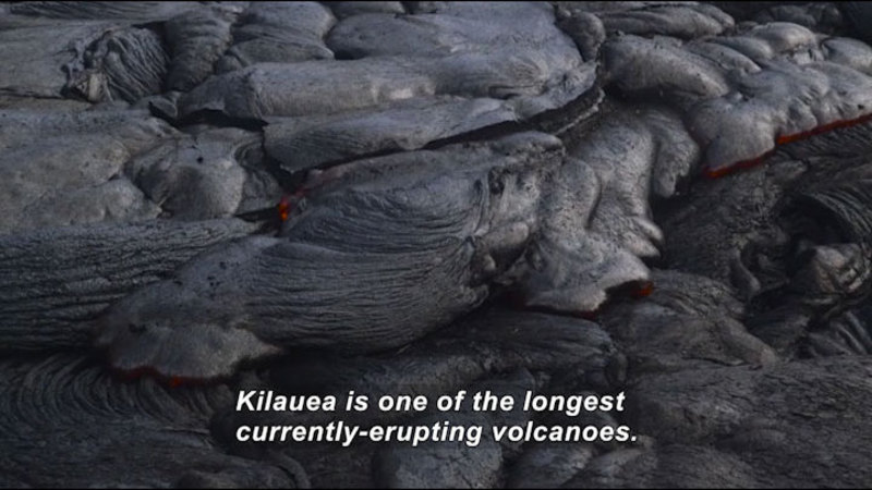 Cooling lava turning into stone. Caption: Kilauea is one of the longest currently-erupting volcanoes.