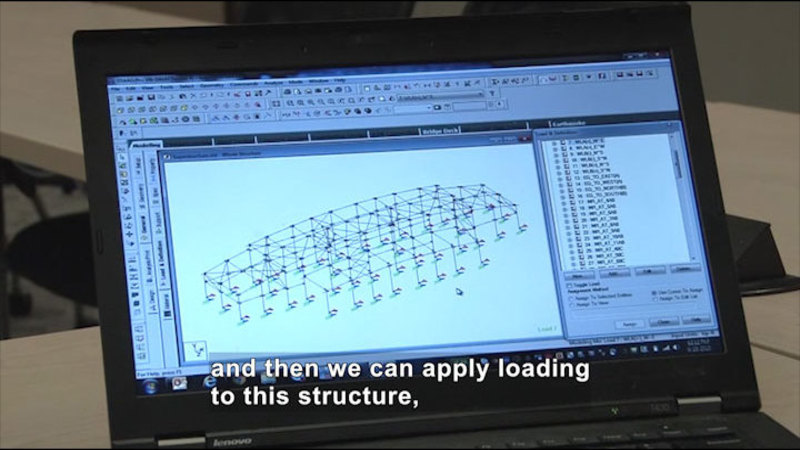Computer screen displaying a grid-like diagram mapping connections between multiple points. Caption: and then we can apply loading to this structure,